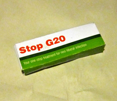 Front of G20 culture jam box. Text reads: Stop G20: Your one-stop treatment for neo-liberal infection.